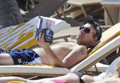 Bon Jovi shirtless reading Bill Clinton's book! Mmmm!