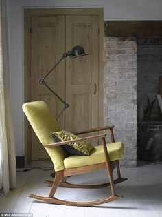 Simon has a keen eye for vintage design and enjoys hunting for one-offs on Ebay and at markets and fairs. 'Packages are always arriving for him,' laughs Marie. He bought the vintage Jieldé floor lamp from Ebay; Made In Design sells them new. The reupholstered vintage rocking chair was a present for Marie's birthday