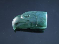 Seahawk Pendant carved by Nathaniel Cook in Blue Ice Nephrite.