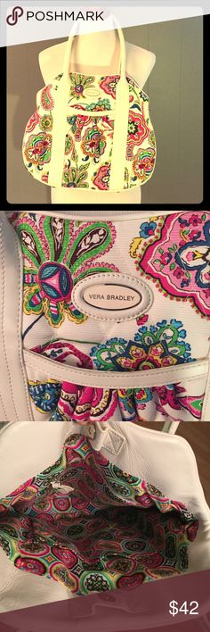 Charming Vera Bradley handbag white leather Fun paisley-patterned Vera Bradley handbag with white leather handles and trim. White with a bright, bold pattern, this purse is in lovely, gently-loved condition. Smoke free/ pet free. Vera Bradley Bags