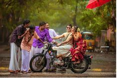 Indian bride and groom on a bike with her brothers stopping them| Indian Wedding Photography| Wedding Photo Ideas| The ultimate guide for the Indian Bride to plan her dream wedding. Witty Vows shares things no one tells brides, covers real weddings, ideas, inspirations, design trends and the right vendors, candid photographers etc.| #bridsmaids #inspiration #IndianWedding | Curated by #WittyVows - Things no one tells Brides | www.wittyvows.com