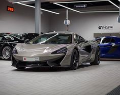 'Your one-stop automotive destination for personalisation and customisation. The largest and most advanced facility of its kind in Bahrain. Contact: +973-17780555 #mclaren #570s #mclaren570s #bahrain #kuwait #instacar #garage #service #q8 #uae #qatar #instadaily #photography #picoftheday#cars #auto #luxury #car #instaphoto #instagood #instacar #ksa' by @kanooperformance.  #cars #car #carporn #watches #carswithoutlimits #watch #designer #interior #gold #porsche #menswear #classy #luxurycars…