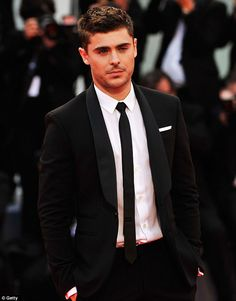 Hollywood star: Zac Efron smoulders on the red carpet at the 69th Venice Film Festival~~He grew up and now looks yummy. ;-)