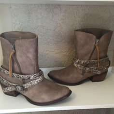 Not rated boots Funky western inspired Not Rated booties. I love the glitter detailing of the straps. Wear with jeans or cute dress. Functional and comfy! Not Rated Shoes Ankle Boots & Booties