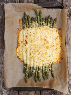 Creamy Aged Cheddar Baked Asparagus...modify: no flour, cream instead of milk, delete egg (for me)