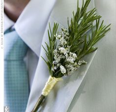 Boutonnieres made of rosemary & small white flowers