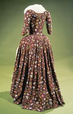 Dress, ca. 1785. Like the contrast between the tight bodice and the full skirt, but wouldn't have liked the corsetry necessary to achieve the look.