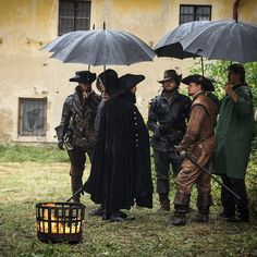 The Musketeers - Umbrellas at the ready on the set of #TheMusketeers II in #Prague. #behindthescenes #bbcone #bbcdrama #originalbritishdrama #onlocation #onset #filming #television #tomburke #athos