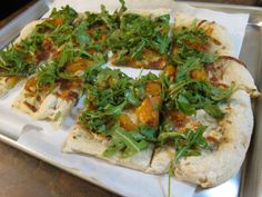 For a unique, yet easy, recipe, try making this Roasted Squash, Gorgonzola, and Arugula Pizza!
