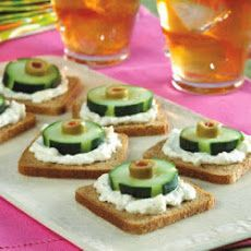 Cucumber and Olive Appetizers Recipe - use white bread circles instead by using a circular cookie cutter!