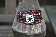 Wrapped Black Leather Bracelet, Strawberry Red, Hot Pink, Iridescent White, Silver Rondelles, Celtic Knot, Stackable, Headband. $39.00, via Etsy.