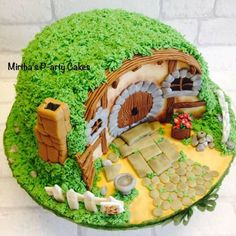 """When a friend asked me to make a Hobbits house theme cake, i jumped with joy! Here is my version made out of 2x 9"""" Madeira cake (triple layer filled with strawberry preserve and vanilla buttercream) I loved creating this one!"""
