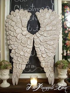 DIY Angel wings made out of cardboard. So beautiful! A lady I work with made these and has them on her office wall. They are really pretty!