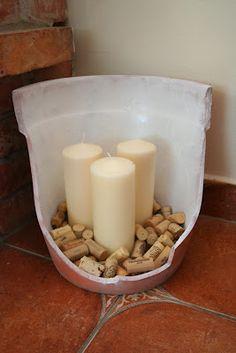 Reusing a broken clay pot as a decorative candle holder