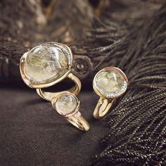 Lotus rings in rutile quartz. Treasured stones formed deep within the Earth's crust and are found in Brazil and Madagascar. #lotuscollection #lotusring #gemstone #rutilequartz #believes #symbols #18k #gold #mothernature #olelynggaardcopenhagen #charlottelynggaard #olelynggaard @charlottelynggaard_dk