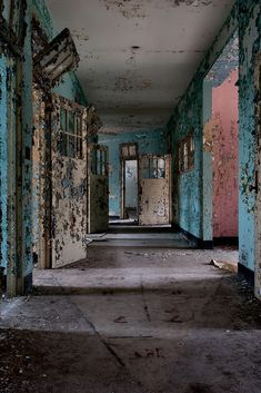 Verden Psychiatric Hospital - Piles of rusted equipment cluttered the permanently dark first floor, while the un-boarded upper floors reflected cascades of bright peeling colors in the sunlight. Seclusion rooms still retained their bed frames, bolted to the floor.
