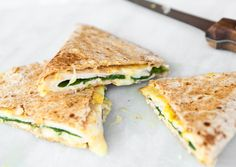 Ham & Cheese Quesadillas Spread mustard on a whole wheat tortilla, then top with slices of Jarlsberg cheese and ham. Add a layer of baby spinach leaves, then fold to enclose and cook on a Panini press or in a hot skillet until the tortilla is golden and the cheese melts. Let cool slightly, then cut into wedges before packing.