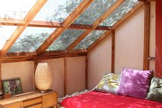 Love the slanted roof and wall of skylights. This would be an incredible bedroom.   Apartment Therapy's Heinz & Veronique's Mid-Century Home + Prefab Cabin + Studio House Tour.