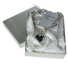 An Engraved Heart Charm Bracelet is a wonderful gift for your bridesmaids that you make unique with a special message. Your chosen personalisation is engraved into the surface of the heart for a lasting memento of your wedding day. #Bridesmaids #Charm #Jewellery #Engraved #Wedding  £28.99