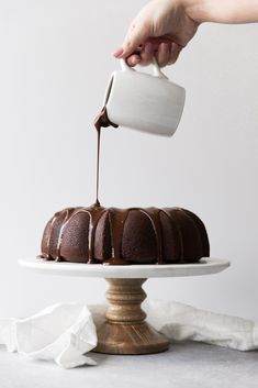 This Chocolate Espresso Cream Cheese Bundt cake is a show-stopper dessert that is sure to please! Decadent chocolate cake, creamy espresso cream cheese filling, luscious dark chocolate ganache and crumbled Oreos. Get the recipe on http://kjandcompany.co - KJ & Company