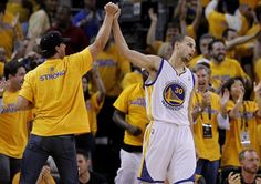 Stephen Curry (30) of the Warriors got a high five from a fan after two points late in the second half. The Golden State Warriors beat the San Antonio Spurs 97-87 in the playoffs Sunday May 12, 2013 at Oracle Arena in Oakland, Calif. Photo: Brant Ward, The Chronicle