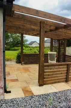 Dark Oak Garden Pavilion and Sandstone. Garden Design, by Tom Leavy_ Leavy Landscaping. Pergola Swing, Porch Swing, Gazebo, Front Porch Design, Garage Design, House With Porch, House Front, Porch Oak, Fiberglass Columns
