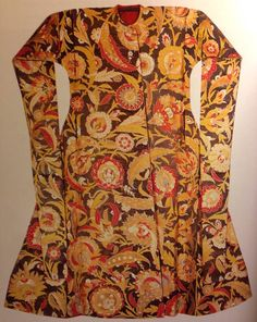 Fig. 202. Caftan. Istanbul. Mid-16th century. Polychrome silk and gilt-metal thread. A ceremonial caftan made of silk textiles made for the Ottoman court. The floral motifs are similar to those found in tiles. This is an example of the intricate saz design used in silk textile, probably worn by Suleyman's son Bayezid. Interestingly, there is no way to fasten the front, causing the wearer to have to remain still while wearing it. pg. 378