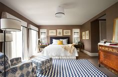 NOTE: Wall color, chevron rug, trimmed lamp shades and gallery wall around bed.