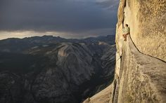 LIVING ON THE EDGE   Photograph by Tim Kemple   The person sitting on that ledge is Alex Honnold. He's been proclaimed the best free soloist (i.e., climbs without ropes) in the world.