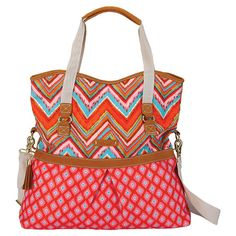 Printed canvas tote bag with leather embellishments.  Product: ToteConstruction Material: Canvas and leather