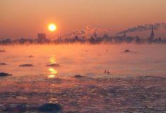 Sun setting on Tallinn, Estonia on a cold winter evening [2048 x 1399] - Imgur