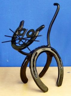 Amazon.com: Horseshoe Kitty Genuine Western Decor Sculpture Art: Home & Kitchen