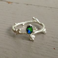Silver Bud Ring with Oval Black Opal