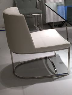 CHI CHI  armless and armed dining chair... Mfg. Whiteline... Design; Stanley Jay Friedman.
