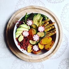 when in doubt opt for the buddha bowl!  big ol' buddha bowl with red rice oven baked potatos steamed asparagus zucchini avocado and radishes in a bed of mixed greens.  #buddhabowl #ricebowl #whatveganseat #veganfoodshare #redrice #highcarb #vegan #veggies #veganfood #vegansofig #plantbased