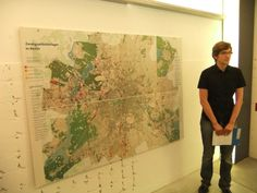 "One of our guides in front of our ""old"" map of the camps in Berlin."
