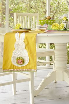 """Although this Pier 1 runner will probably be the talk of your Easter table, we still think it's hard to say """"Ruffled Bunny Tail Table Runner"""" fives times quickly."""