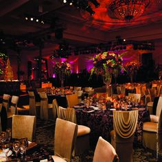 Fall Color Palette: Red, Purple, And Cream    Intricate tablecloths, draped chair covers, and purple uplighting create a beautiful ambiance.
