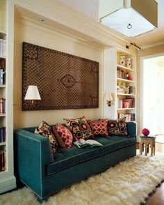 Love the built in bookcases creating a cozy space for the couch and the pillows instead of couch cushions on the back: