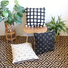 This pillow is a clean modern black and white grid on the front, with a luxe washed linen back.  The front of this pillow is made from handwoven cotton Ikat, which we get from an amazing company who creates this textile in the traditional way, NOT in a large factory...its handwoven! This black and white grid weave is prewashed twice to prevent bleeding. The handwoven nature of this fabric means you can see the gradiated weave within this geometric pattern, however please note there could…
