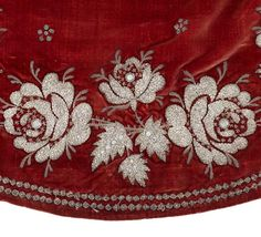 "Court train, First Empire From the Chateau de Malmaison Costume Collection app: ""This court train was found at the residence of the descendants of the family of Empress Josephine's son, Prince Eugene. It is a different type of train, not silk or tulle but velvet, and has extensive embroidery along the edges. The etiquette established under the Empire encouraged the use of such heavy, precious fabrics as Napoleon wished to revitalise the fabric manufacturing industry in Lyon."""