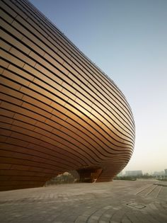 The polished metal exterior is beautiful. Ordos Art & City Museum> MAD Architects