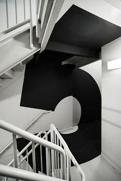 Wit en zwart - grafisch design geïntegreerd in interieur architectuur
