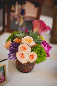 Bright flowers with succulents by Butterfly Petals