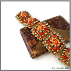 INTERMEDIATE Right Angle Weave, Peyote and Picot stitch Bead Weaving pattern Small Beaded Tiles with 3D detail in the centre of each tile make up this textured and unusual cuff. 18cm long - quick and easy to make.