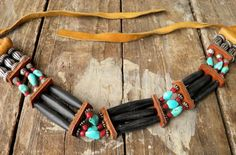 Bone horn pipe strands with antiqued fluted barrel silver beads, metal rondells, Sleeping Beauty Blue Turquois, red clay seed beads with elkskin ties, artificial sinew string and leather strips.