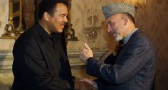 """KABUL, AFGHANISTAN - NOVEMBER 17: Former world heavyweight boxing champion, Muhammad Ali (L), is greeted by Afghan President Hamid Karzai at the palace November 17, 2002 in Kabul, Afghanistan. Ali is in Kabul on a three-day mission as a special guest of the UN as the """"U.N. Messenger of Peace."""" (Photo by Paula Bronstein/UNICEF/Getty Images)"""
