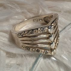 925 Sterling Silver Ring Absolutely beautiful, it's just too big for me. It's never been worn, like new. .925 sterling silver stamp on the inside of the band. It looks kind of gold in the photos but I promise you it's silver. Jewelry Rings