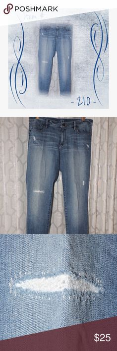 Ann Taylor LOFT Curvy Skinny Jeans Previously loved distressed lightly faded wash jeans.  They are in excellent condition.  Fit is contoured to flatter hips and thigh.  They are mid-rise with a slim, streamlined fit from hip to hem. Regular length. LOFT Jeans Skinny
