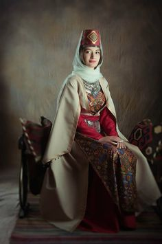 Central Asia | Portrait of a woman wearing traditional clothes, Armenia